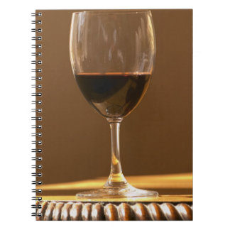 A glass of red Chateau Belgrave in sunlight - Notebook