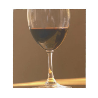 A glass of red Chateau Belgrave in sunlight - Notepad