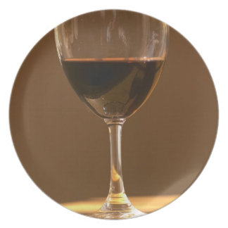 A glass of red Chateau Belgrave in sunlight - Plate