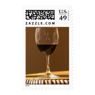 A glass of red Chateau Belgrave in sunlight - Postage Stamps