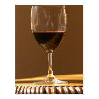 A glass of red Chateau Belgrave in sunlight - Postcard