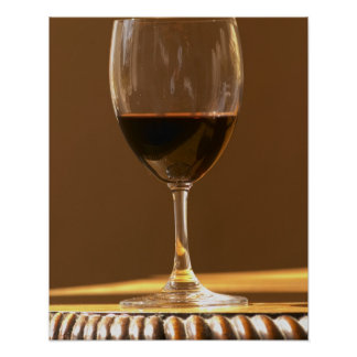 A glass of red Chateau Belgrave in sunlight - Print
