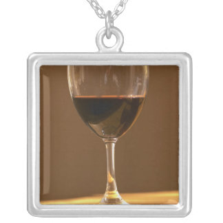 A glass of red Chateau Belgrave in sunlight - Square Pendant Necklace
