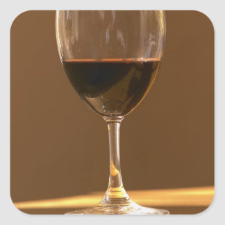 A glass of red Chateau Belgrave in sunlight - Square Sticker