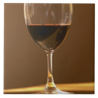 A glass of red Chateau Belgrave in sunlight - Tile