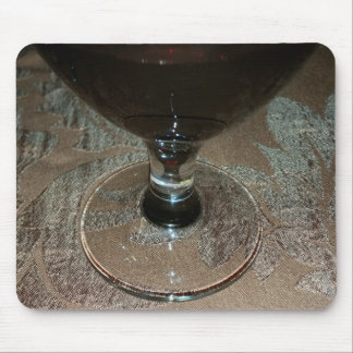 a glass of red wine mouse pad