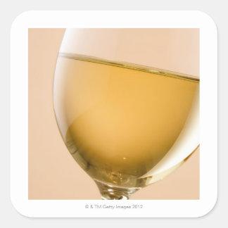 A glass of white wine square sticker