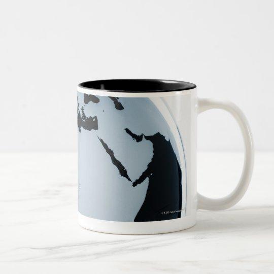 A globe Two-Tone coffee mug