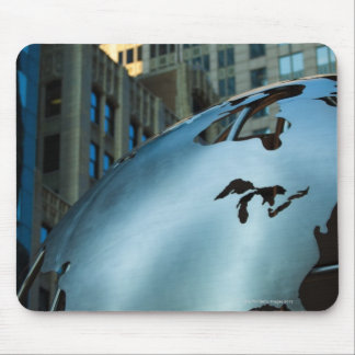 A globe with a stainless steel North America Mouse Pad