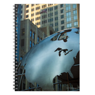A globe with a stainless steel North America Notebook