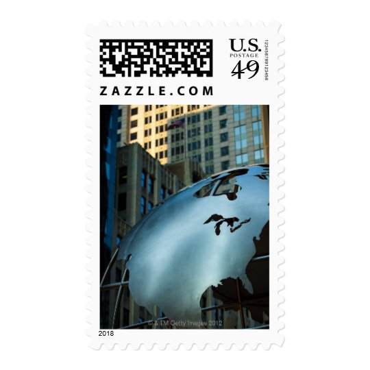 A globe with a stainless steel North America Postage