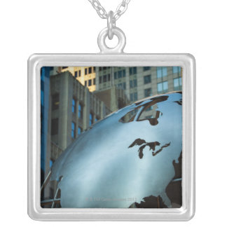 A globe with a stainless steel North America Silver Plated Necklace