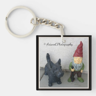 A gnome and his dog key chain