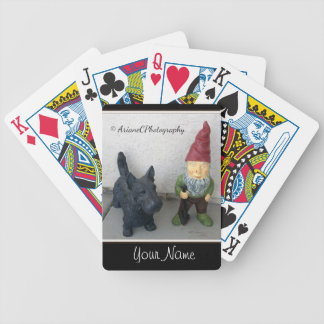 A gnome and his dog playing cards