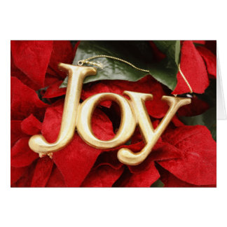 A gold JOY hanging Christmas ornament Card