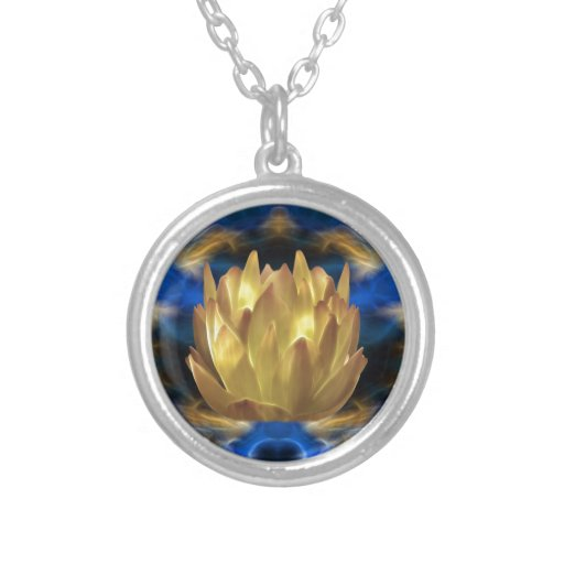 A gold lotus flower and reflections round pendant necklace