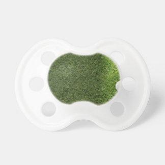 A Golf Ball On A Grass Surface BooginHead Pacifier