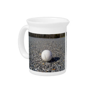 A golf Ball resting on gravel Beverage Pitchers