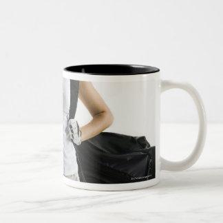 A golfer 2 Two-Tone coffee mug