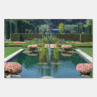 A great picture of a fountain garden. lawn sign