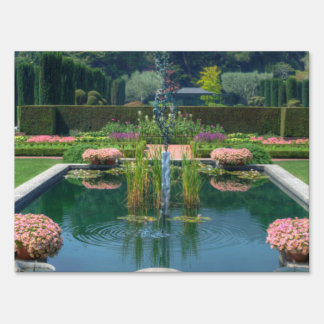 A great picture of a fountain garden. yard sign