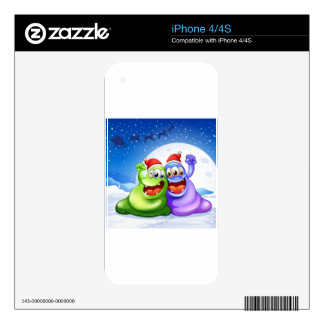A green and a violet monster wearing a red hat for iPhone 4 decal