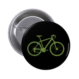 a green bicycle 2 inch round button