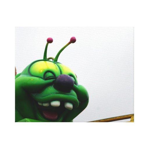 A green caterpillar goofy fair ride image canvas print