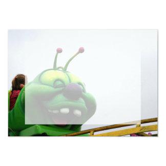 A green caterpillar goofy fair ride image announcement