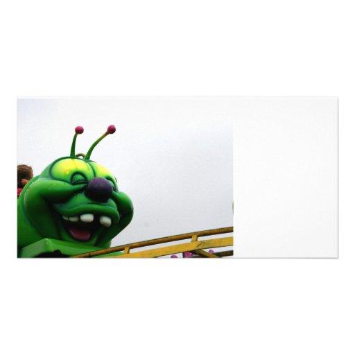 A green caterpillar goofy fair ride image photo card