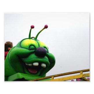 A green caterpillar goofy fair ride image photo art