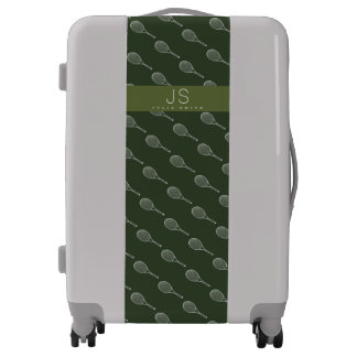 a green pattern of tennis racquets on gray luggage