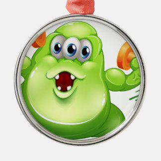 A greenslime monster with orange dumbbells round metal christmas ornament