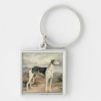 A Greyhound in a hilly landscape Keychain