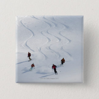 A group of backcountry skiers follow their guide button