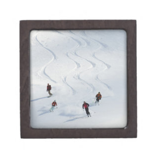 A group of backcountry skiers follow their guide gift box