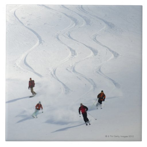 A group of backcountry skiers follow their guide ceramic tiles