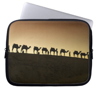 A group of camel herders with their camels at computer sleeve