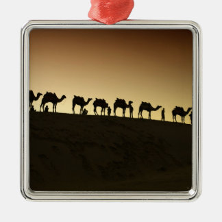 A group of camel herders with their camels at metal ornament