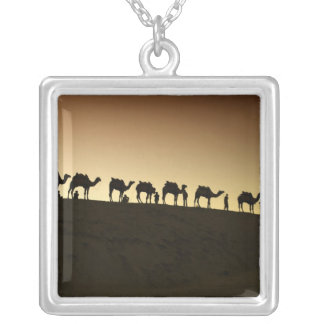 A group of camel herders with their camels at square pendant necklace