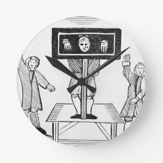 A Guilty Man in the Village Pillory, copy of a 16t Round Wallclocks
