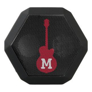 a guitar with custom initial black bluetooth speaker