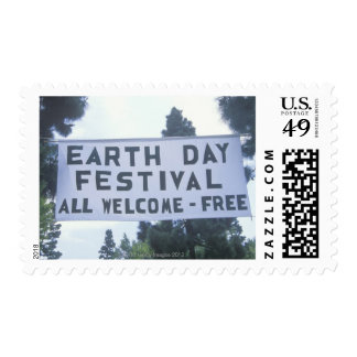 A hanging sign welcoming people to the Earth Day Postage Stamp