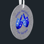 """A Hanukkah Dreidels In Blue Cute Kids Chrismukkah Ornament<br><div class=""""desc"""">The Chrismukkah tradition is about love of family and blending two holidays into memories that embrace both beliefs. This Happy Hanukkah ornament with double Dreidels in bold colors of vivid blue and crisp white set on a faux silver background will look good on a Hanukkah bush, a Christmas tree or...</div>"""
