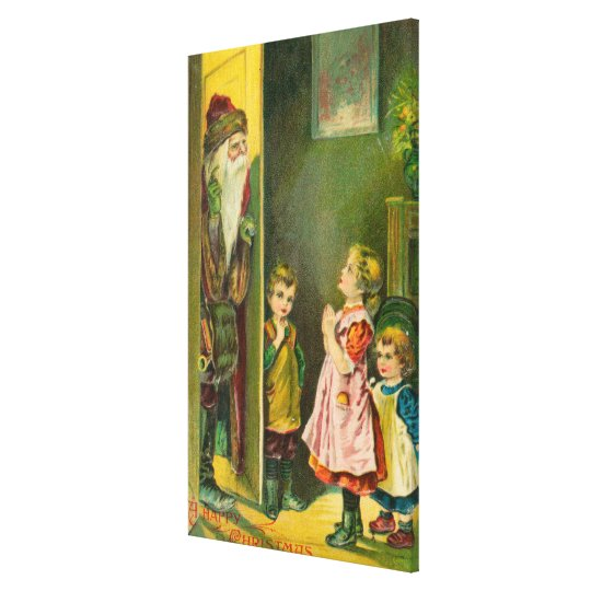 A Happy Christmas Kids Letting Santa In Canvas Print