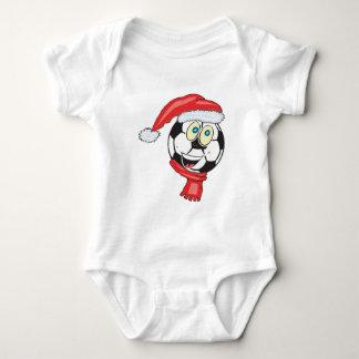 A happy christmas soccer ball wearing a santa hat baby bodysuit
