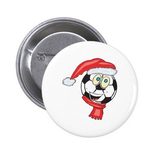 A happy christmas soccer ball wearing a santa hat pinback button