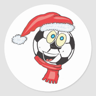 A happy christmas soccer ball wearing a santa hat classic round sticker