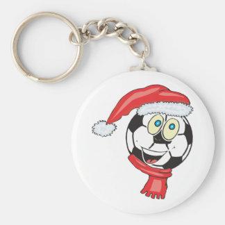 A happy christmas soccer ball wearing a santa hat keychain
