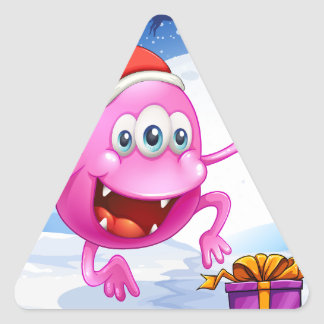 A happy pink beanie monster wearing Santa's hat Triangle Sticker